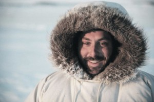 joel-heath-conducting-field-work-wearing-an-eider-down-parka-during-winter-in-the-canadian-arctic-600x398